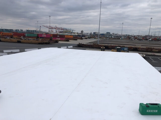 flat roof covered in white tpo roofing material