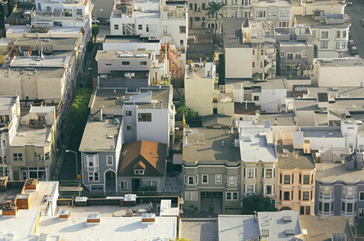 aerial view of buildings with flat roof installation