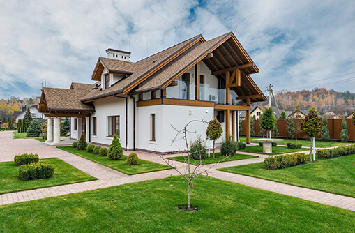 white residential villa on green grass with chesapeake custom roof design
